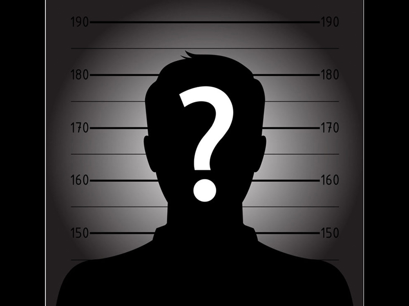 Mugshot of a criminal with a question mark of face.
