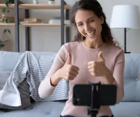 Woman giving two thumbs off while on a video call