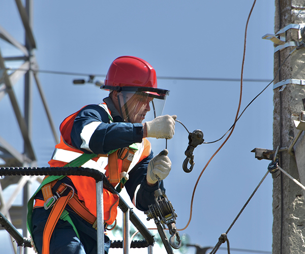 Man working on electric line