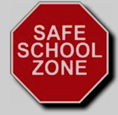 """Stop sign that says """"Safe School Zone"""""""